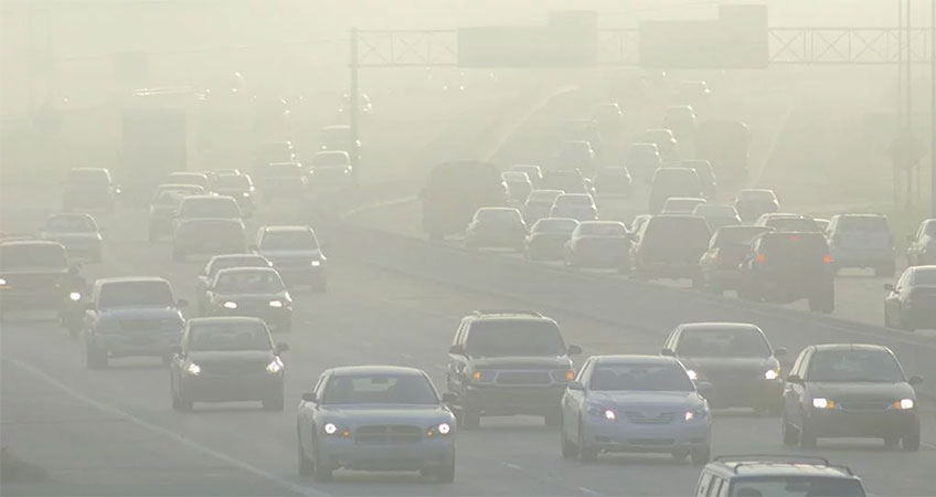 Image of cars on a highway with heavy smog.