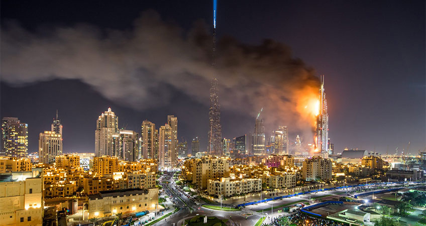 Image of a skyscraper with a fire in it.