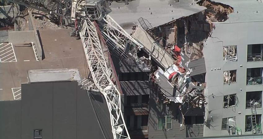 A crane collapsed onto an apartment complex in Dallas, killing one.