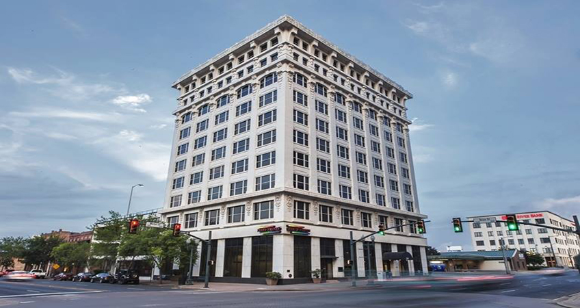 The neo-classical building was built with steel and previously housed several offices on the top floors.