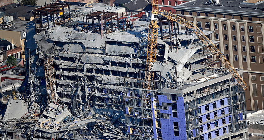 Demolition crews used explosives to try to safely take down the cranes, which were each more than 250 feet (76 meters) tall, from the building's damaged shell.
