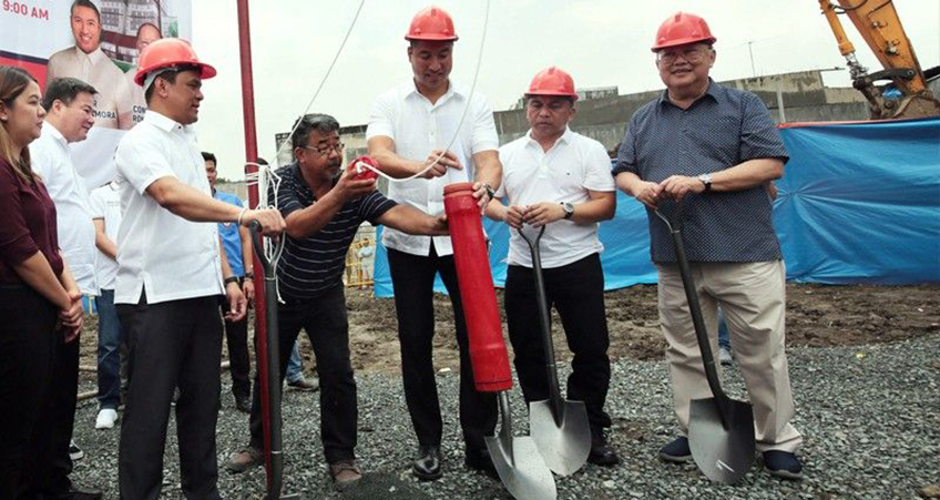 A groundreaking ceremony is held for a much-needed public housing tower in San Juan City.
