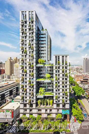 Tower A's apartments have extended balconies with trees, while and Tower B's apartments have a soft, green creeper mesh screen on their façades.