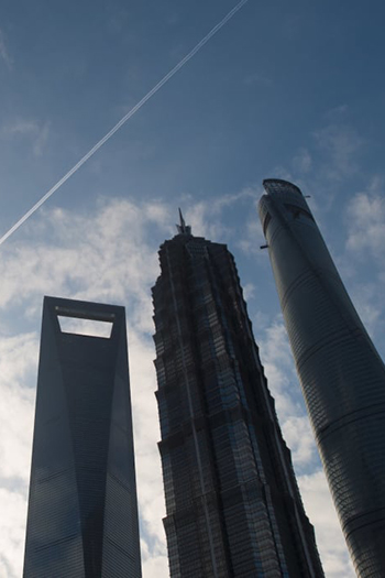 Limits on supertalls, like the 492-meter Shanghai World Financial Center (left) are among the topics being discussed in a round of new legislation changes released in China.