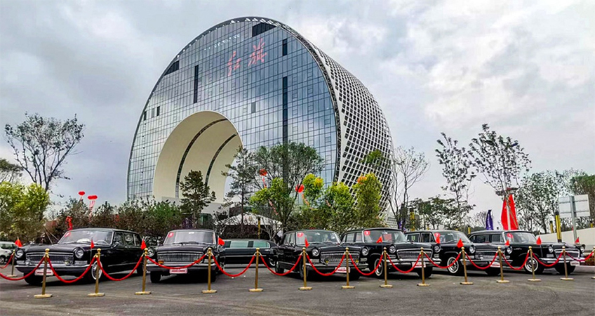 The new, semi-circular building is located in Changchun's International Auto City, which is a hub for the auto industry.