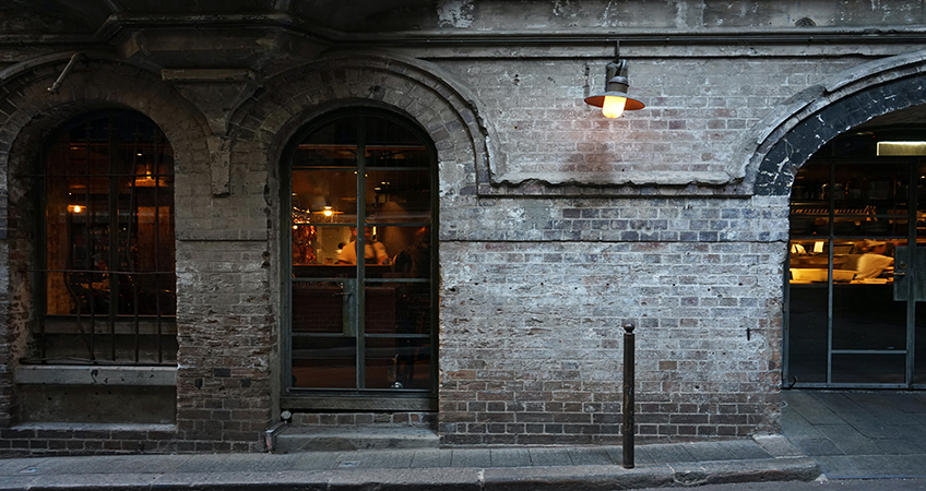 Sydney's industrial past features masonry arches, as seen in this alleyway, a motif reinterpreted in the office building proposed for Green Square. Image credit: Photo by Rose Lamond on Unsplash