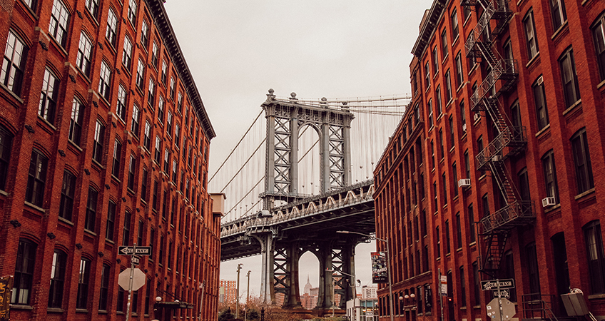 Olympia Dumbo near the Brooklyn Bridge in New York has topped out at 26 stories.  Photo by Miltiadis Fragkidis on Unsplash