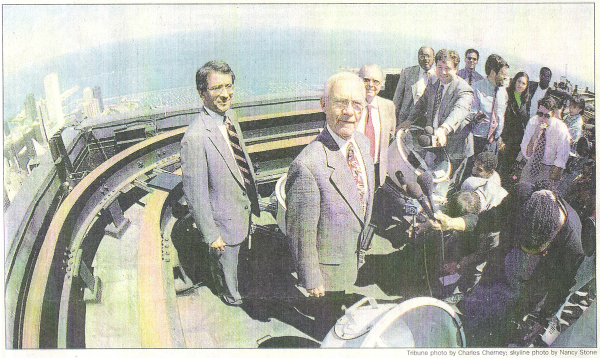 Image from newspaper coverage of the passing of CTBUH Chairmanship from do Valle to Nair on the rooftop of the Sears Tower Chicago. From left to right: R. Shankar Nair, Lynn S. Beedle, Gilberto do Valle